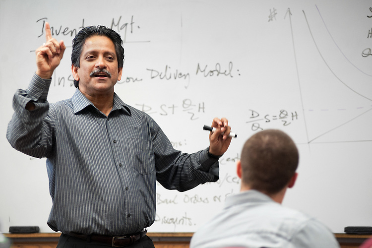 Professor of Operations Management Faizul Huq leads students in discussion during  a classroom session for an online MBA class. Photo by: Ross Brinkerhoff.