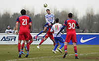 Cole Kpekawa of QPR rises highest to win a header