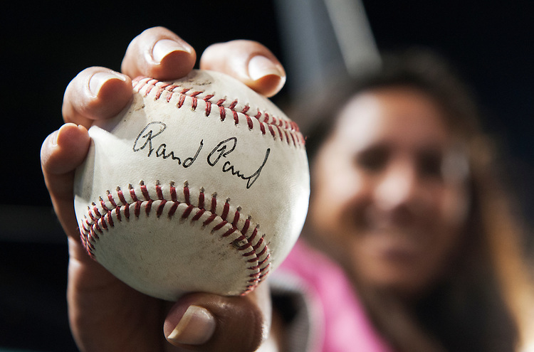 UNITED STATES - JUNE 25: Jennifer Morris shows off a ball autographed by Sen. Rand Paul, R-Ky., during the 53rd Congressional Baseball Game in Nationals Park, June 25, 2014. The Democrats prevailed over the Republicans 15-6 in a rain shortened game. (Photo By Tom Williams/CQ Roll Call)