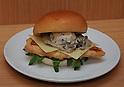 December 27, 2011, Tokyo, Japan - Premium grilled chicken sandwich with truffles and porcini mushrooms is one of four types of Japan Premium products Wendys hamburger restaurant offers as the American fast-food chain reopens its door in Japan with the launch of its first eatery at Tokyos bustling Omotesando area on Tuesday, December 27, 2011. (Photo by Natsuki Sakai/AFLO) [3615] -mis-