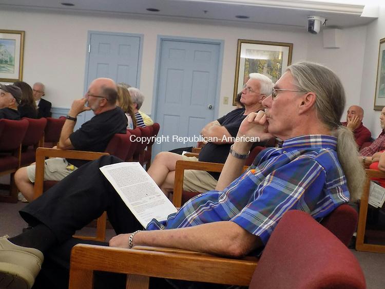 Joe Corbett and other Wolcott residents listen during the public hearing. Aidan Quigley Republican American
