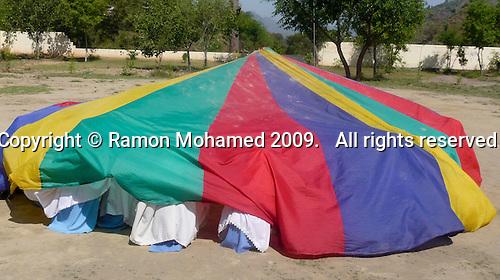 Parachute games, Matayal Girls School, Kotli area, Azad Kashmir, Pakistan.  Built with donations from the UK Kashmiri community.
