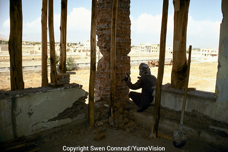 The reconstruction of the wall, destroyed during the civil war 1992-1996, at the second floor of the National Museum in 1999..Under the Taleban government in 1996-2001, the National Museum star to be rebuild. Kabul, Afghanistan.