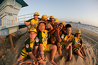 26 September 2011: 2011 Little League Baseball World Series Championship team portrait northside of the Huntington Beach Pier at sunset in Southern California.  Ocean View team WEST beat Hamamtsu City, Japan, 2-1, to become the seventh team from California to win the title on August 28, 2011 in South Williamsport, PA.