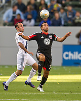 CARSON, CA - March 18,2012: LA Galaxy midfielder Landon Donovan (10) and DC United forward Dwayne De Rosario (7) during the LA Galaxy vs DC United match at the Home Depot Center in Carson, California. Final score LA Galaxy 3, DC United 1.