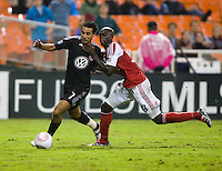 Mamadou Danso (93) of the Portland Timbers fights for the ball with Dwayne De Rosario (7) of D.C. United during the game at RFK Stadium in Washington, D.C. D.C. United tied the Portland Timbers, 1-1.