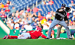 22 April 2010: Colorado Rockies' first baseman Todd Helton attempts a pick-off play against a diving Nyjer Morgan during a game against the Washington Nationals at Nationals Park in Washington, DC. The Rockies shut out the Nationals 2-0 gaining a 2-2 series split. Mandatory Credit: Ed Wolfstein Photo