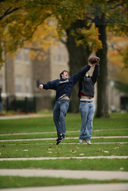 Students playing football on North Quad