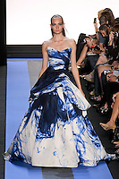 Nimue walks runway in an ink faille strapless tufted ball gown, by Monique Lhuillier, from the Monique Lhuillier Spring 2012 collection fashion show, during Mercedes-Benz Fashion Week Spring 2012.