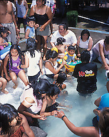 A crowded paddling pool at one of 4 Urban beaches recently inaugarated in Mexico City, as many as the beaches consist of swimming pools, 120 tons of sand, volleyball courts, industrial fans to mimic the wind, they are free and enourmously popular, as many as 4000 people (although designed for 3000) line up early in the morning to enjoy its instalations.  Villa Olimpica, Mexico City, Easter Sunday, April 8, 2007