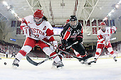 Catherine Ward (BU - 17), Katie MacSorley (NU - 3) (Lorms) - The Northeastern University Huskies tied Boston University Terriers 3-3 in the 2011 Beanpot consolation game on Tuesday, February 15, 2011, at Conte Forum in Chestnut Hill, Massachusetts.