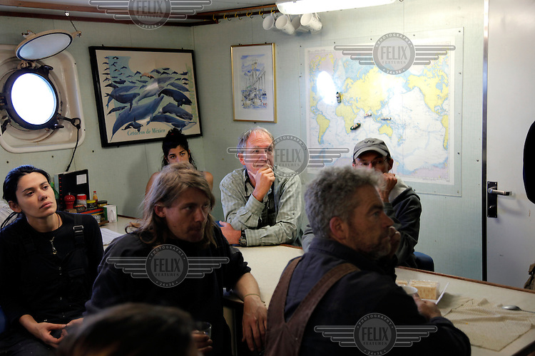 Greenpeace activists and crew members during a briefing on board the Arctic Sunrise ship during its European sustainable fisheries tour.