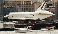 Space Shuttle Enterprise makes its way up by Hudson River to be placed at the Intrepid Sea, Air and Space Museum in New York, June 6, 2012.  Photo by Eduardo Munoz Alvarez / VIEW.