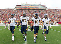 California captains' Chris Guarnero, Cameron Jordan, Mike Mohamed and Kevin Riley walk on the field for coin toss before the game against USC at LA Memorial Coliseum in Los Angeles, California.  USC defeated California, 48-14.
