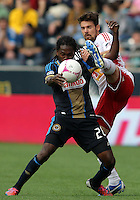 CHESTER, PA - OCTOBER 27, 2012:  Keon Daniel (26) of the Philadelphia Union is almost kicked in the head by  Heath Pearce (3) of the New York Red Bulls during an MLS match at PPL Park in Chester, PA. on October 27. Red Bulls won 3-0.