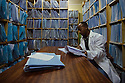 A doctor looks through files in the file room. Addis Ababa, Ethiopia.