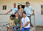 In Abucay, a seaside town in the Philippines province of Bataan, leaders of the Persons With Disabilities Abucay Federation gather in front of their office.