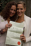 Leigh and Helena holding marriage license from Boston after informal backyard ceremony, &quot;Sacred Union Celebration&quot; in Philadelphia<br /> <br /> Release # 2528