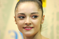 "Anna Bessonova of Ukraine smiles at ""Kiss & Cry"" area during event finals at World Championships at Baku, Azerbaijan on October 4, 2005. Bessonova won silver in All-Around. (Photo by Tom Theobald)"