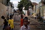 Jamaican boys play along one of Kingston's inner-city ghetto streets June 15, 2008. Jamaican boys are disproportionately likely to fall victim to violence, making up close to 75-85% of the total percentage of murder victims annually.