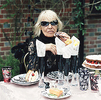 Anita Pallenberg having afternoon tea served outside Pearl Lowe's Hampshire country house