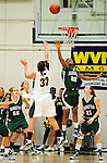 5 December 2009: University of Vermont Catamount forward/center Lauren Buschmann (32), a Freshman from St. Catharines, Ontario, takes a shot as Manhattan College Jaspers' Toni-Ann Lawrence (20) tries to defend during the second half of play at Patrick Gymnasium in Burlington, Vermont. The Catamounts defeated the visiting Jaspers 78-59 to mark the Lady Cats' second home win of the season. Mandatory Credit: Ed Wolfstein Photo