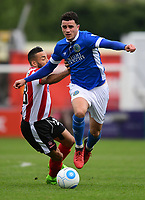 Lincoln City's Nathan Arnold vies for possession with Macclesfield Town's Oliver Norburn<br /> <br /> Photographer Chris Vaughan/CameraSport<br /> <br /> Vanarama National League - Lincoln City v Macclesfield Town - Saturday 22nd April 2017 - Sincil Bank - Lincoln<br /> <br /> World Copyright &copy; 2017 CameraSport. All rights reserved. 43 Linden Ave. Countesthorpe. Leicester. England. LE8 5PG - Tel: +44 (0) 116 277 4147 - admin@camerasport.com - www.camerasport.com