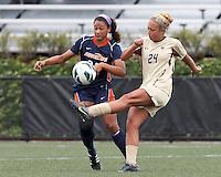 Boston College forward Rachel Davitt (24) clears the ball as Pepperdine University forward Lynn Williams (25) closes. Pepperdine University defeated Boston College,1-0, at Soldiers Field Soccer Stadium, on September 29, 2012.