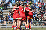 27 February 2016: Maryland's Taylor Cummings (behind, left) celebrates her goal with Taylor Hensh (20), Megan Whittle (23), and Taylor Cummings (21). The University of North Carolina Tar Heels hosted the University of Maryland Terrapins in a 2016 NCAA Division I Women's Lacrosse match. Maryland won the game 8-7.