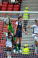 Glasgow, Scotland - July 25, 2012: Abby Wambach and Hope Solo of the US women's national soccer team defend the goal during USA's 4-2 win over France.