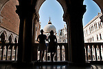 Two women admire the view from the balconies of the Doge's Palace in Venice, Italy