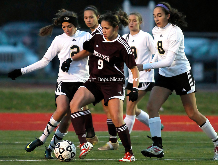 Wolcott, CT-01 November 2012-110112CM08- Naugatuck's Stephanie Lima (9) is swarmed by Wolodland's Alaina Nedderman (2), Shea Geary (9) and Andrea Piccolo (8) during their NVL semi final matchup Thursday night in Wolcott.  Woodland won 3-1 and will play Watertown in the finals on Saturday.  Christopher Massa Republican-American