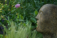 A detail of the sculpture illustrating the informal planting surrounding it