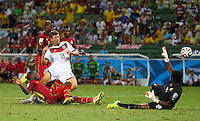 Kwadwo Asamoah of Ghana produces a last ditch tackle to deny Thomas Muller of Germany a late winning goal