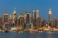 The Manhattan skyline at twilight as viewed over the Hudson River from New Jersey.