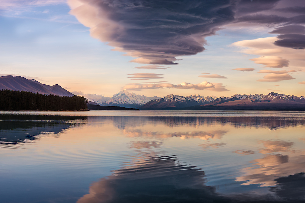 Mount Cook and lenticular clouds reflected in Lake Pukaki