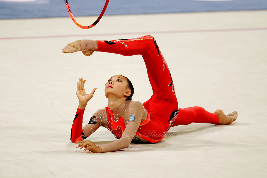 Aliya Yussupova competing for Kazakhstan recatches hoop during All-Around final at Athens Olympic Games on August 29, 2004 at Athens, Greece. (Photo by Tom Theobald)