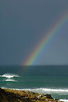 Rainbow and waves off the Otago Peninsula, New Zealand