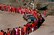 Wasco, OR, February 1984. <br /> Disciples of Bhagwan Rajneesh, wait in line along the roads of Rajneeshpuram to greet him during  his daily trip through the community in his Rolls-Roys. Bhawan Rajneesh (now known as Osho) possessed more than 20 Rolls-Royce cars and never used the same car two days in a row. Rajneeshpuram, was an intentional community in Wasco County, Oregon, briefly incorporated as a city in the 1980s, which was populated with followers of the spiritual teacher Osho, then known as Bhagwan Shree Rajneesh. The community was developed by turning a ranch from an empty rural property into a city complete with typical urban infrastructure, with population of about 7000 followers.