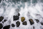Waves crashing over the rocks at St Clair Beach in Dunedin, New Zealand