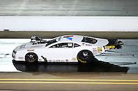 Sep 13, 2013; Charlotte, NC, USA; NHRA pro mod driver Mike Janis during qualifying for the Carolina Nationals at zMax Dragway. Mandatory Credit: Mark J. Rebilas-