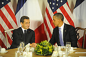 United States President Barack Obama shakes hands with President Nicolas Sarkozy of France at the Waldorf Astoria Hotel in New York, New York on Wednesday, September 21, 2011 ..Credit: Aaron Showalter / Pool via CNP
