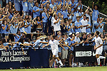 19 September 2014: North Carolina's Tyler Engel (8) celebrates his goal with fans along the fence. The Duke University Blue Devils hosted the University of North Carolina Tar Heels at Koskinen Stadium in Durham, North Carolina in a 2014 NCAA Division I Men's Soccer match. Duke won the game 2-1.