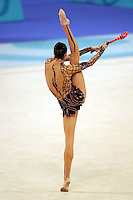 Anna Bessonova of Ukraine stag turns pirouette with clubs during qualifications round at 2004 Athens Olympic Games on August 27, 2006 at Athens, Greece. (Photo by Tom Theobald)