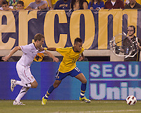 Brazil forward Neymar (11) and USA defender Jonathan Spector (2) chase down a pass. Brazil  defeated the US men's national team, 2-0, in a friendly at Meadowlands Stadium on August 10, 2010.