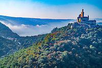 Marksburg Castle in fog,  Rhine River, Germany , Rhineland Region. 13th Century Castle Upper Middle Rhine Valley UNESCO World Heritage Site
