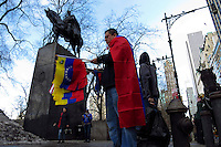 A man sells flags while Venezuela Immigrants supporters of Leopoldo Lopez and Henrrique Capriles take part in a protest against Venezuelas president Nicolas Maduro in Central park, New York. FEB 23, 2014. Photo by Eduardo Munoz Alvarez/VIEWpress