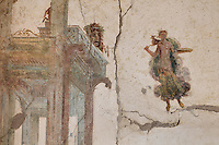 Fresco detail of an architectural framework from the court of Bacchus, a floating figure with deer and a classical theatre tragey mask, in the Triclinium, probably used for lunches, a large room open to the garden, with walls painted on a white background with figures and plants and ornamental borders and floating figures of the seasons, in the Casa dell Efebo, or House of the Ephebus, Pompeii, Italy. This room is decorated in the Fourth Style of Roman wall painting, 60-79 AD, a complex narrative style. This is a large, sumptuously decorated house probably owned by a rich family, and named after the statue of the Ephebus found here. Pompeii is a Roman town which was destroyed and buried under 4-6 m of volcanic ash in the eruption of Mount Vesuvius in 79 AD. Buildings and artefacts were preserved in the ash and have been excavated and restored. Pompeii is listed as a UNESCO World Heritage Site. Picture by Manuel Cohen