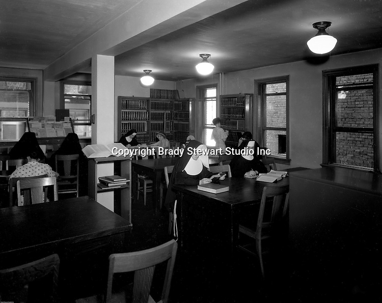 Pittsburgh PA: Catholic Sisters and students in the Duquesne University library - 1932