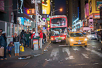 A New York Sightseeing tour bus parked in Times Square in New York on Tuesday, March 17, 2015.  (© Richard b. Levine)